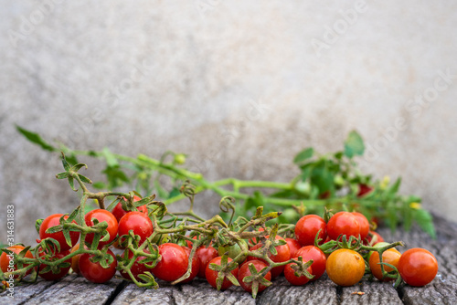 Red ripe fresh organic tomato on rustic brown wood background