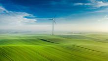 Wind Turbine On Green Field At...