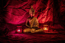 A Golden Buddha Statue On Red ...