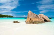 Bright Scenic View Of Granite Boulder Landscape Of Anse Lazio Beach On Praslin Island In The Seychelles