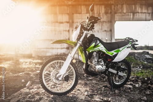 Fotomural  Beautiful green off-road motorcycle Enduro or cross, in a contoured light