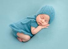 Cute Newborn In Knitted Suit
