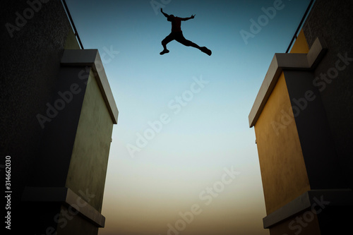 Cuadros en Lienzo Concept of jumping over obstacles, The silhouette of a man jumping between two tall buildings