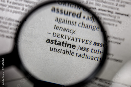 Photo The word or phrase astatine in a dictionary.