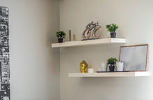 White Wall. Shelves With Statu...