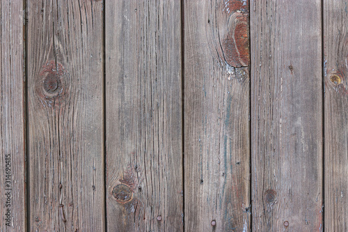 Old shabby wooden planks with cracked brown color paint, Rural country background