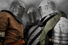 Three Medieval Knights In Armor.
