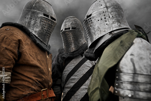 Three medieval knights in armor. Canvas Print