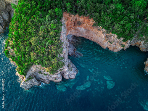 Aerial view of a steep cliff, unspoiled nature of the Montenegro coast Canvas Print