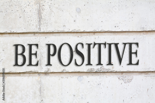 written BE POSITIVE words on concrete wall background Wallpaper Mural