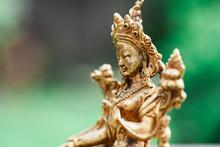 Figure Of A Female Buddhist Deity (Green Tara) Sitting On A Lawn