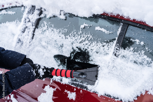 obraz PCV Woman Cleaning Car From Snow