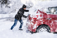 Man Pushing A Car Stuck In The...