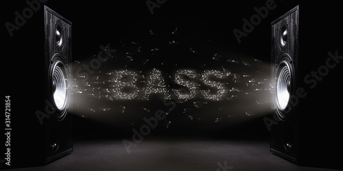 Photo Two sound speakers with text bass between them on black  background