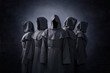 canvas print picture - Group of five scary figures in hooded cloaks in the dark