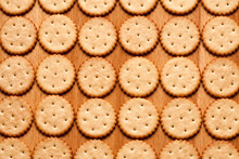 Round Crackers On Wood Backgro...