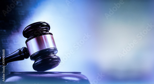 Fotografía Law concept image, gavel set against bright computer monitor screen background