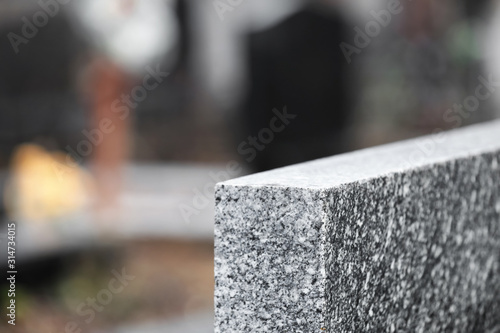 Photo Light grey granite tombstone outdoors, closeup with space for text