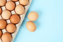 Raw Chicken Eggs On Light Blue...