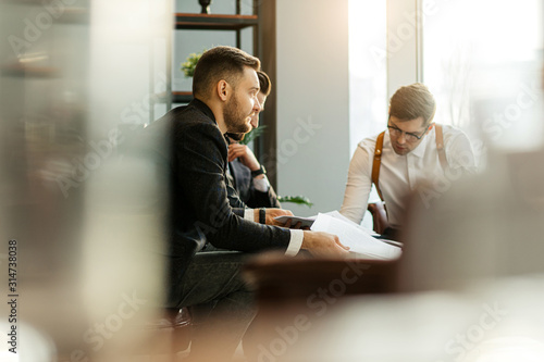 Obraz successful business partners coworking in office, caucasian leaders in tuxedo gathered for developing business projects and ideas, frinedly business team at meeting - fototapety do salonu