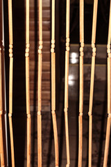 Wooden curtains in the form of sticks of wood