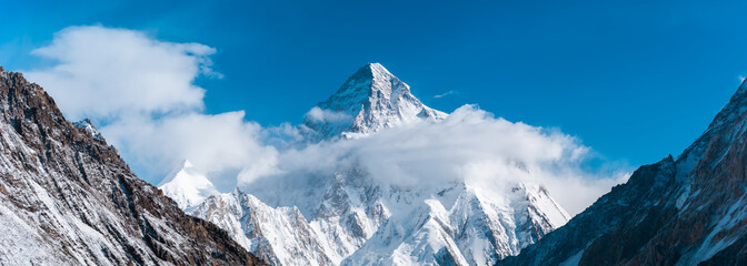 Fototapeta Góry Close up panoramic view of K2, the second highest mountain in the world with Angel peak and Nera peak on the left side, Concordia, Pakistan