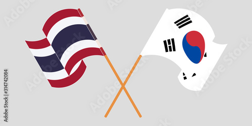 Crossed and waving flags of Thailand and South Korea Canvas Print