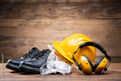 Fototapeta Yellow Hard Hat With Safety Equipment obraz