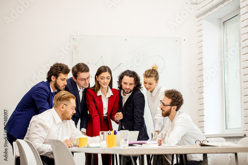 Fototapety, obrazy: friendly business people co-working in modern office, enjoy working together, using laptop and having successful useful conversation, discussion