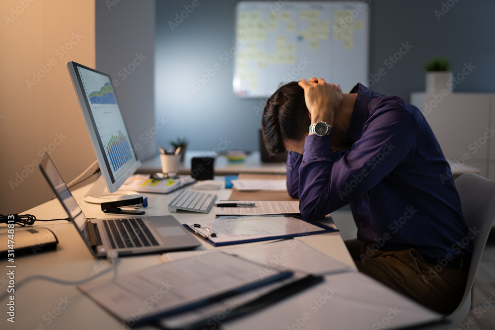 Fototapeta Stressed Accountant Working Late In Office