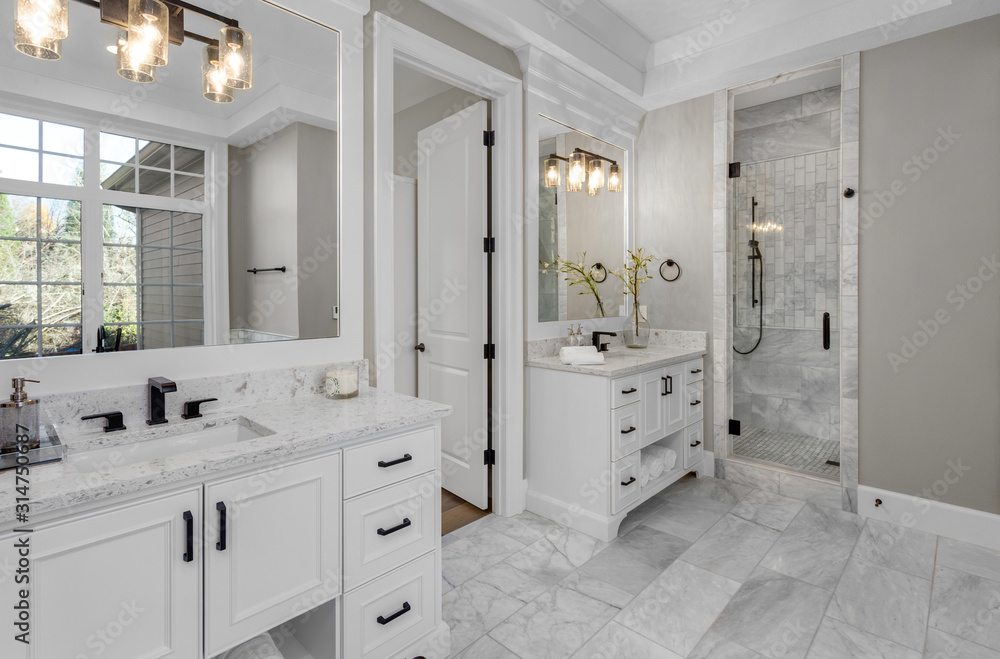 Obraz Beautiful bathroom in new luxury home with two vanities, sinks, and mirrors Shows shower with tile and wand fototapeta, plakat