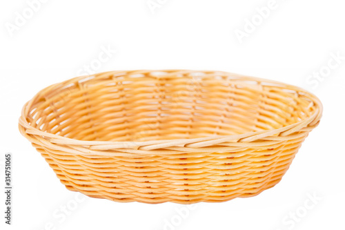 Obraz na plátně Wicker basket isolated on white background