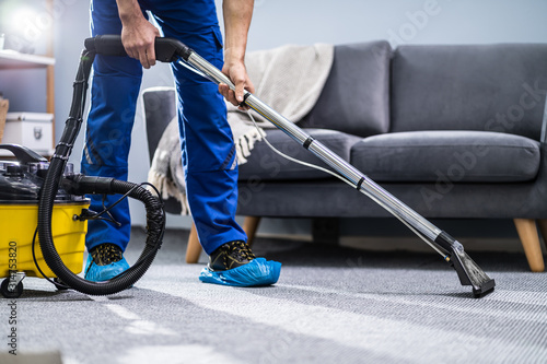 Fototapeta Person Cleaning Carpet With Vacuum Cleaner obraz