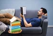 Man Reading Book At Home