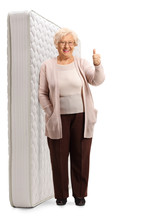 Elderly Woman Posing Next To A...