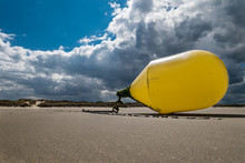 Closeup Of A Yellow Buoy Tied At The Beach Waiting For The Next High Tide