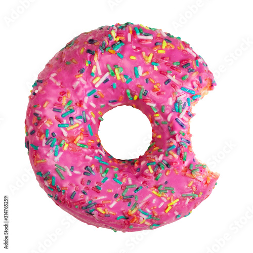 Fototapeta Flat lay of bitten donut decorated with colorful sprinkles isolated on white background. Take a bite concept obraz