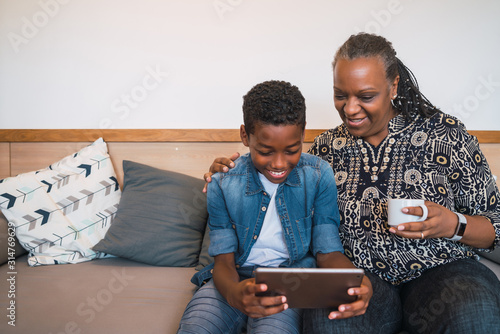 Obraz Grandmother and grandchild taking selfie with tablet. - fototapety do salonu