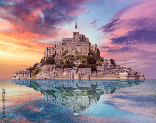 Mont saint michel twilight with reflection in the water and dramatic sky cloud Fotobehang
