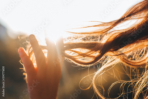 Woman touches the lock of hair. Selective focus