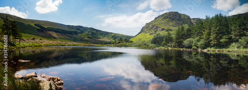 Scenic lake and mountains reflection of glentanassig woods in the Dingle Peninsula, County Kerry, Ireland