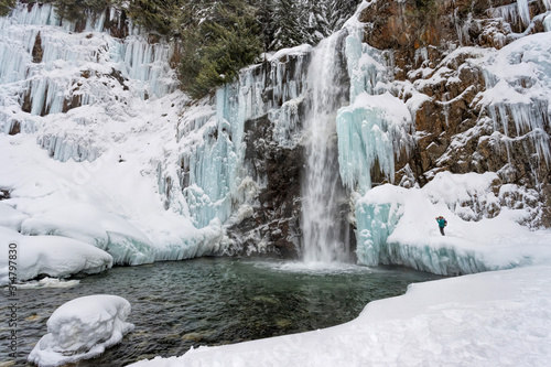 Waterfall covered in ice during the winter