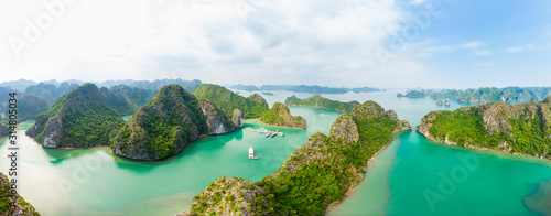 Aerial view of Ha Long Bay Cat Ba island, unique limestone rock islands and karst formation peaks in the sea, famous tourism destination in Vietnam Fototapete