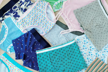 A Lot Of Children's Underwear. Underwear For Children In The Form Of Shirts And Pants. Clothing For Girls And Boys. Background From Underwear Of Different Types. Cotton Underwear.