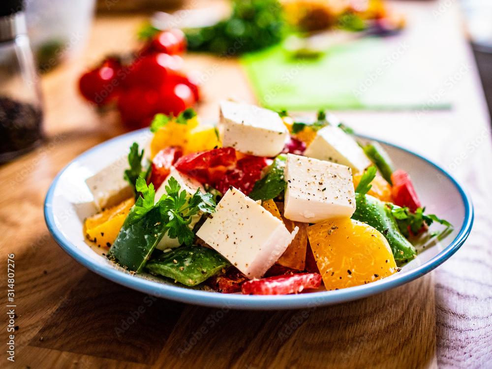 Fototapeta  Fresh greek salad on wooden background