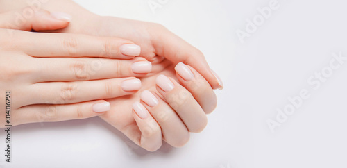 Valokuvatapetti Stylish trendy nail young woman hands pink manicure on white background