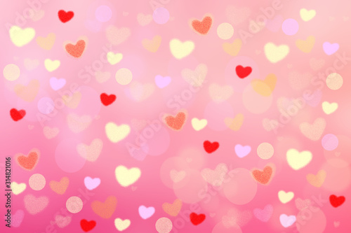 Abstract festive blur bright pink pastel background with colorful hearts love bokeh for wedding card or Valentines day.  Romantic textured backdrop with space for your design. Card concept.