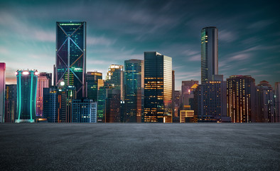empty asphalt road with beautiful night cityscape scene .