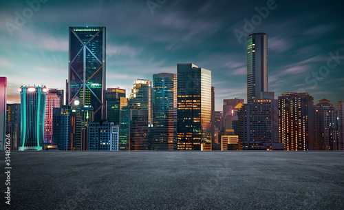 empty asphalt road with beautiful night cityscape scene . #314821626