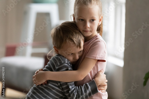 Fotografie, Tablou Small children brother and sister hug showing love